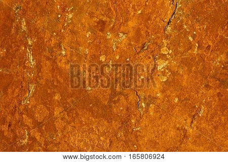 abstract rust pattern - the corrosion on a flat stone surface that contains iron ore creates this rusty texture