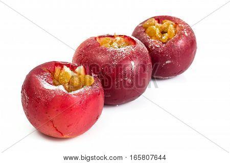 Baked apple with raisins on a white background . Studio Photo