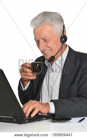 Portrait of a mature man using laptop wearing headphones