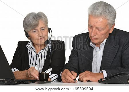 Portrait of a serious mature couple at work