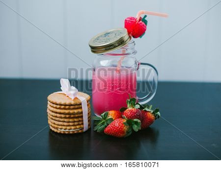 Strawberry fruit drink. Creamy cookies. Sweet cocktail