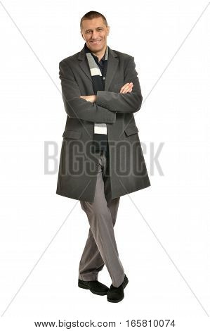 Handsome Man in coat with crossed hands on a white background