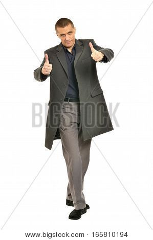 Handsome Man in coat showing thumbs up on a white background