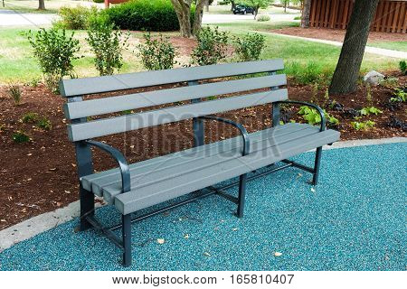 A Bench is on the floor in the park