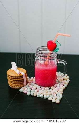 Strawberry fruit drink. Creamy cookies. Multi-colored candy