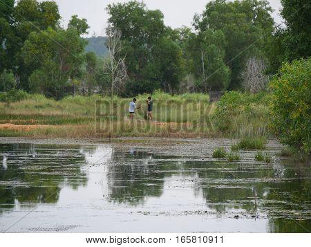 31 december 2016 otres beach sihanoukville cambodia two young fishermen repairing fishing nets lake editorial