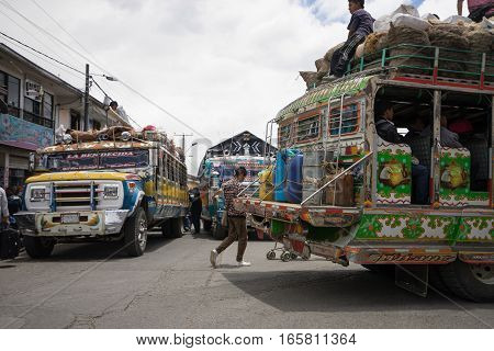 September 6, 2016 Silvia Colombia: a colourfully decorated old bus called 'chivas' drives through the center of the small mountain town transporting people to the local market