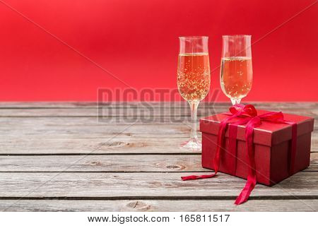 champagne glasses and the red gift box