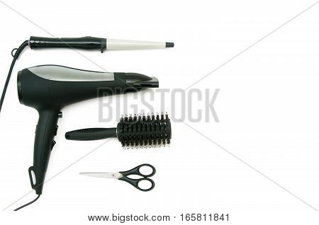 Collection of curling iron, hair dryer, comb and scissors