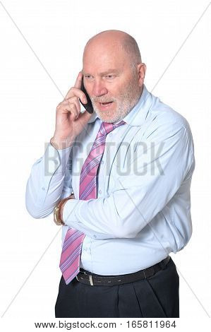 mature businessman talking on the phone, on white background