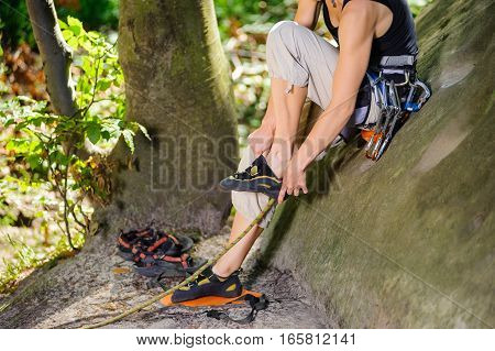 Climber Putting Climbing Shoes On - Close Up