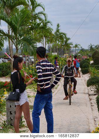 31 december 2016 otres beach sihanoukville cambodia young asian couple facing each other on a small path close to the beach editorial