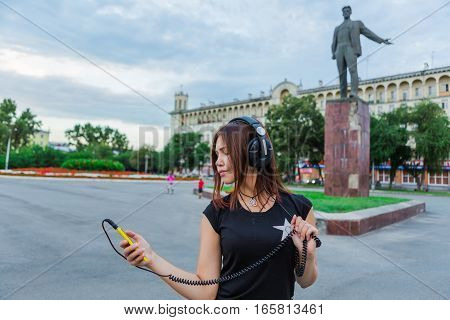Asian Girl Listening To Music With Headphones