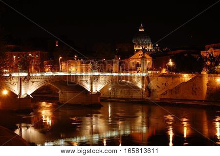 Night view on bridge Ponte Sant Angelo with reflections