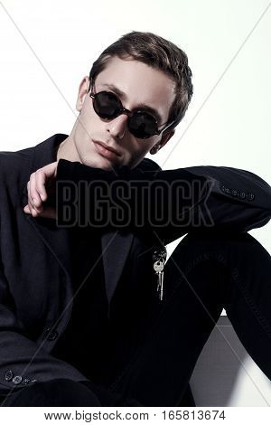 Portrait Of A Handsome Fashion Man In Sunglasses On White Background