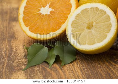 Citrus fruits. Oranges and lemons. Over wood table