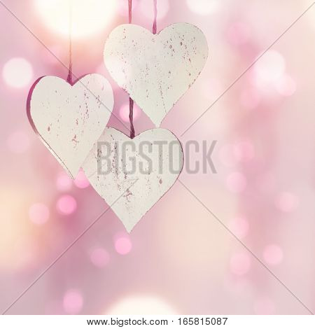 Love heart in front of a pink background with bokeh for Valentines Day or Mothers Day