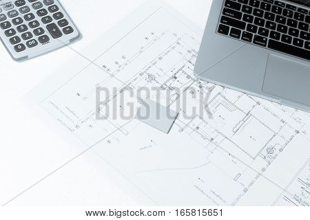 Calculator, And Notebook Over House Construction Blueprint With Blue Tone Effect