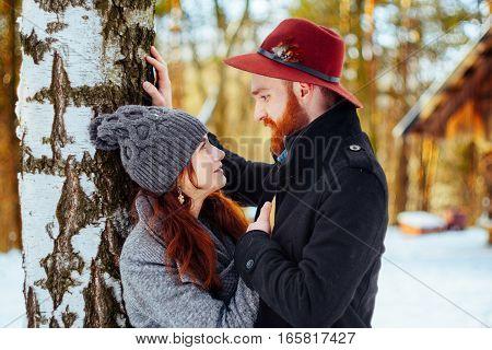 couple in love outdoor winter beautiful sun glare.