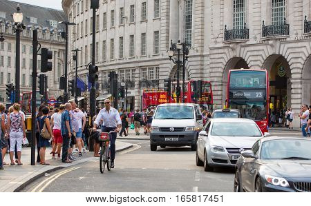 London, UK - August 24, 2016:  Regent street junction with lots of people and traffic on the road