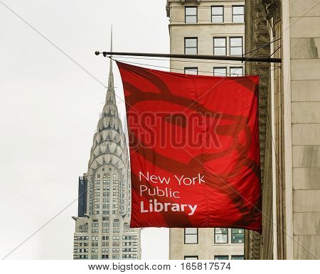 New York USA november 2016: Chrysler building with the New York public library banner in foreground