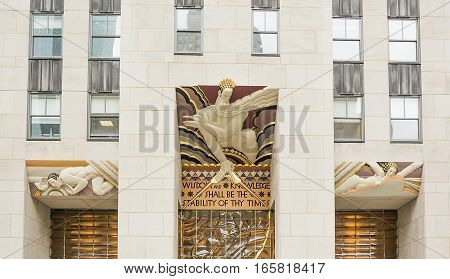 New York, USA, november 2016: Wisdom, an art deco piece by Lee Lawrie over the entrance of 30 Rockefeller plaza in New York, NY