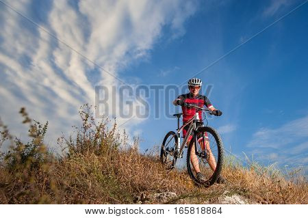 Cyclist Riding His Bike Down On Mountain Trail
