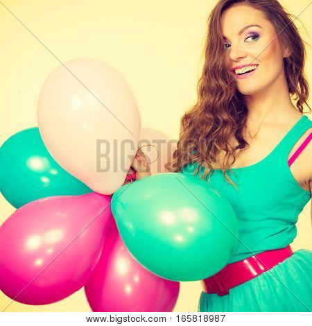 Woman Holding Bunch Of Colorful Balloons