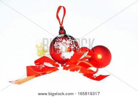 Christmas tree toy red bow Snowflake in snow on white background.
