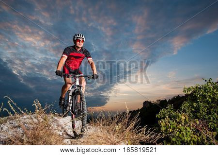 Cyclist On Mountain Bike Races Downhill In The Nature