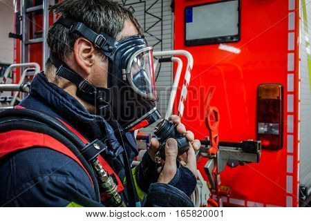 HDR - Firefighter with oxygen mask in action