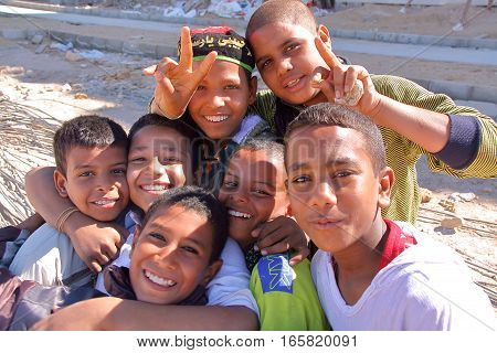 LUXOR, EGYPT - NOVEMBER 6, 2011: Seven welcoming young Egyptian boys posing on the East bank of the Nile