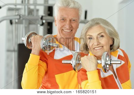 Portrait of a mature couple working out sport concept
