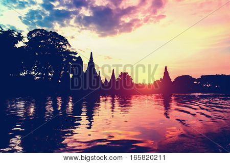 Landscape silhouette vintage style of Wat Chaiwatthanaram during sunset next to the Chao Phraya River is ancient temple famous religious attraction of Ayutthaya Historical Park Thailand