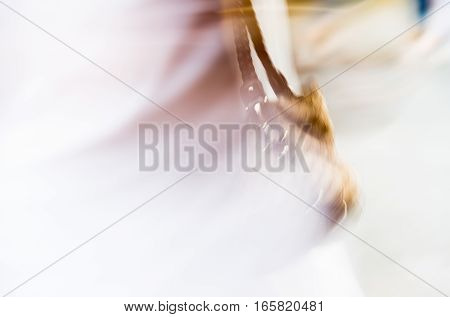 Blurred image of lades hand bag. Young woman walking with hand bag, UK