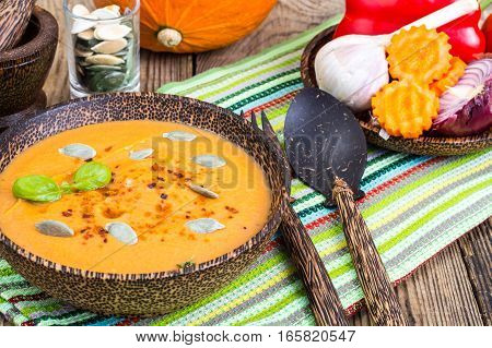 Spicy vegetable soup with curry and red pepper. Studio Photo
