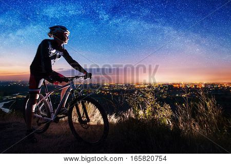 Bicyclist With Mountain Bike On Top Of The Hill