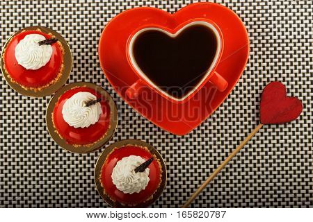 Red cup of coffee in the shape of a heart for lovers. Valentine Day concept.