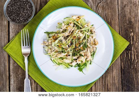 Chicken salad, fresh vegetables and chia seeds. Studio Photo