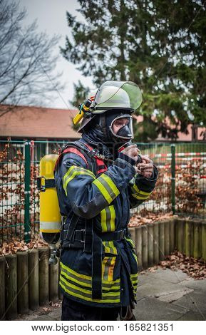 HDR - Firefighter with breathing mask and oxygen cylinder
