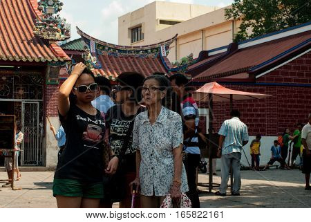Penang, Malaysia, July 2015 - Family in front of temple, grandmother, mother daughter