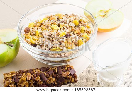 Muesli In A Glass Bowl, Milk And Fresh Apple