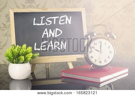 Listen And Learn on blackboard with clock and flare
