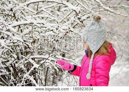 Funny Little Girl Having Fun In Beautiful Winter Park During Snowfall