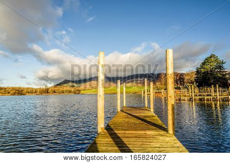 A wooden jetty on Derwentwater in the English Lake District.