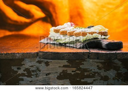 Natural appetizer of cottage cheese toasts. Fire lighting background