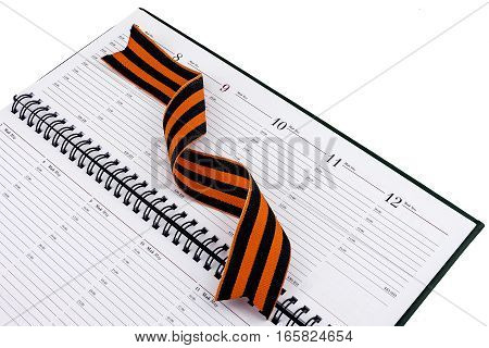 In an open diary sheet is St. George's ribbon twisted spiral