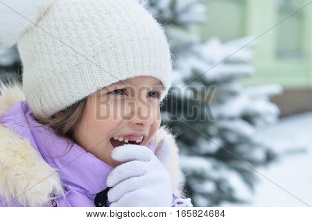 happy smiling little girl posing outdoor in winter