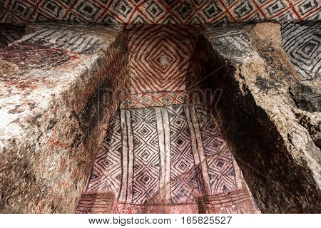 pre-columbian underground burial chamber in Tierradentro Colombia  with ancient paintings