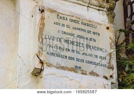 Goa, India - November 16, 2012: Information plaque at the entrance to the Menezes Braganza Pereira House - old colonial Villa-Museum of Portuguese era in Goa, India.